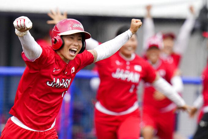 Japan's Eri Yamada celebrates their win over Mexico during their softball game at the 2020 Summer Olympics, Thursday, July 22, 2021, in Fukushima , Japan. (AP Photo/Jae C. Hong)