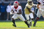 Georgia running back D'Andre Swift (7) rushes against Georgia Tech during the first half of an NCAA college football game Saturday, Nov. 30, 2019 in Atlanta. (AP Photo/John Amis)