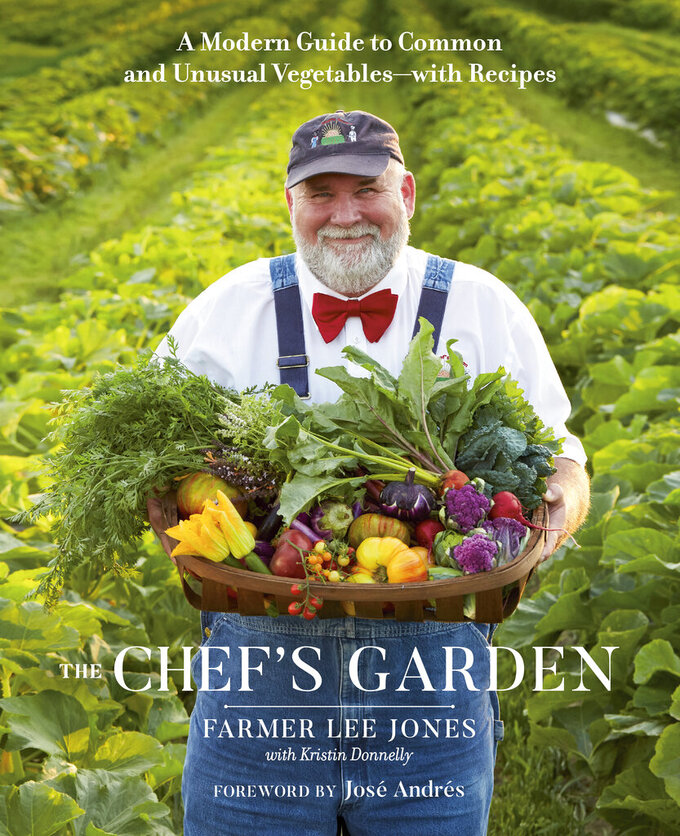 """This cover image released by shows """"The Chef's Garden: A Modern Guide to Common and Unusual Vegetables — with Recipes"""" by Farmer Lee Jones. The 640-page handsome book is equal parts vegetable reference bible, family memoir and recipe collection. (Avery via AP)"""