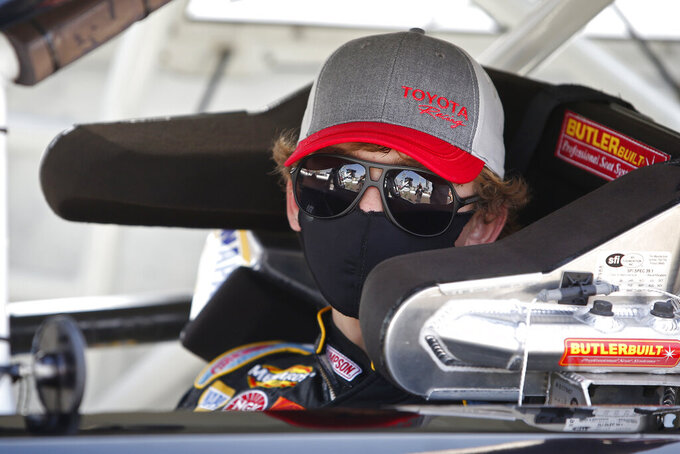 Jesse Love peers out from his race car prior to the ARCA Series auto race at Phoenix Raceway, Saturday, Nov. 7, 2020, in Avondale, Ariz. (AP Photo/Ralph Freso)