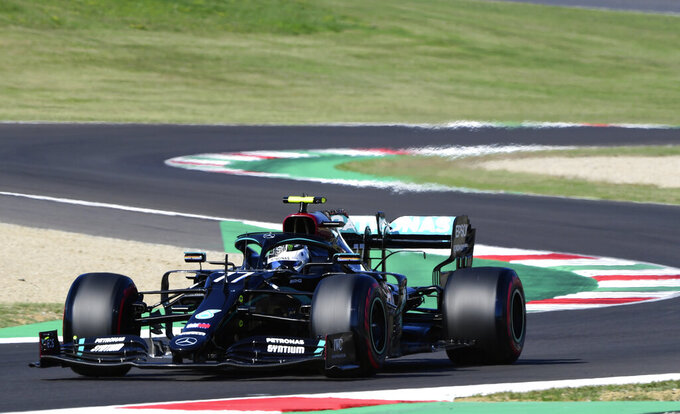 Mercedes driver Valtteri Bottas of Finland steers his car during qualification ahead of the Grand Prix of Tuscany, at the Mugello circuit in Scarperia, Italy, Saturday, Sept. 12, 2020. The Formula One Grand Prix of Tuscany will take place on Sunday. (Jennifer Lorenzini, Pool via AP)