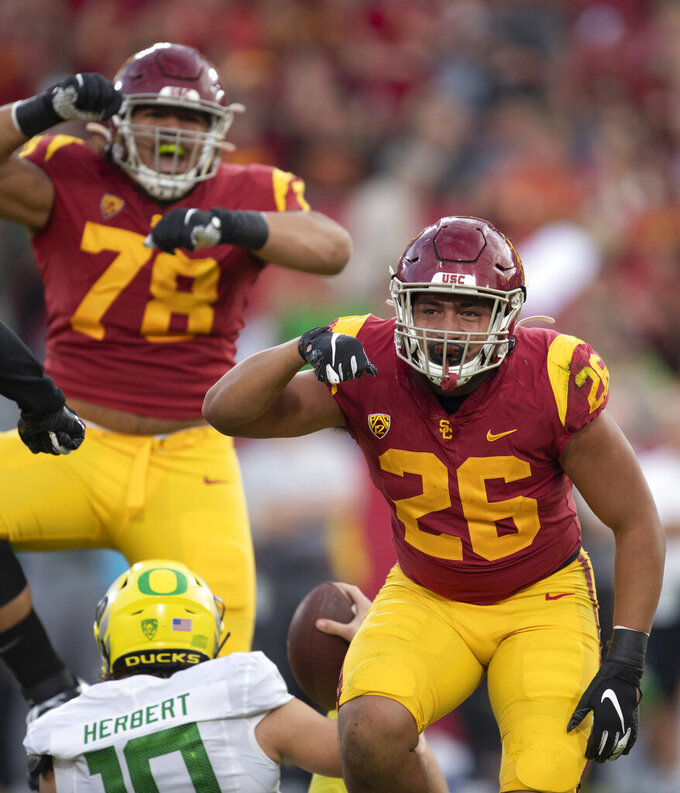 Southern California linebacker Kana'i Mauga, right, celebrates his sack against Oregon during the first half of an NCAA college football game Saturday, Nov. 2, 2019, in Los Angeles. (AP Photo/Kyusung Gong)