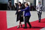 German Chancellor Angela Merkel, center, welcomes the Prime Minister of New Zealand Jacinda Ardern, left, for a meeting at the chancellery in Berlin, Germany, Tuesday, April 17, 2018. (AP Photo/Markus Schreiber)