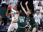 Michigan State's Xavier Tillman, left, maneuvers against Binghamton's George Tinsley, center, and Yarden Willis, right, during the first half of an NCAA college basketball game Sunday, Nov. 10, 2019, in East Lansing, Mich. (AP Photo/Al Goldis)