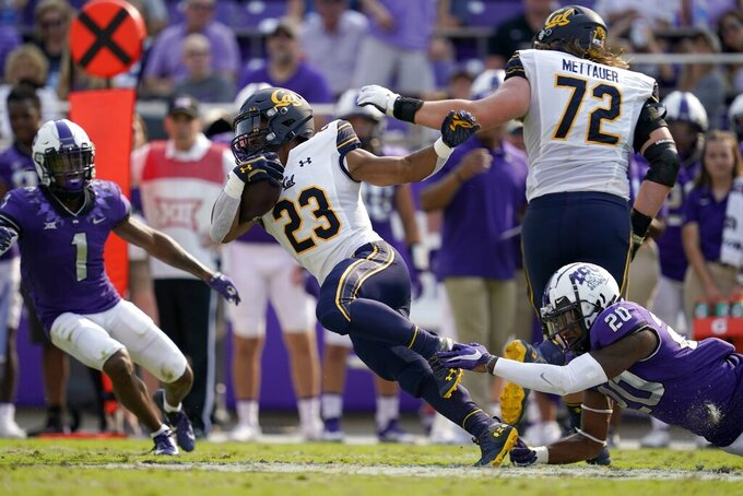 California running back Marcel Dancy (23) is caught from behind by TCU safety La'Kendrick Van Zandt (20) as Tre'Vius Hodges-Tomlinson (1) and California's McKade Mettauer (72) look on in the second half of an NCAA college football game in Fort Worth, Texas, Saturday, Sept. 11, 2021. (AP Photo/Tony Gutierrez)