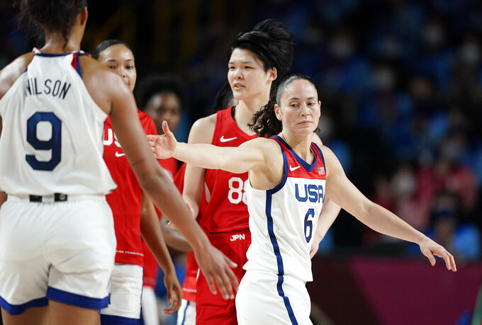 United States' Sue Bird (6), right, celebrates with teammate A'Ja Wilson (9) at the halftime during women's basketball gold medal game against Japan at the 2020 Summer Olympics, Sunday, Aug. 8, 2021, in Saitama, Japan. (AP Photo/Charlie Neibergall)