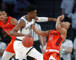 Georgia Tech forward Khalid Moore (12) fouls Virginia Tech guard Justin Robinson (5) as he drives in the first half of an NCAA college basketball game Wednesday, Jan. 9, 2019, in Atlanta. (AP Photo/John Bazemore)