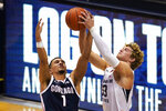 Gonzaga guard Jalen Suggs (1) battles for a rebound with BYU forward Caleb Lohner (33) in the second half of an NCAA college basketball game, Monday, Feb. 8, 2021, in Provo, Utah. (AP Photo/Rick Bowmer)