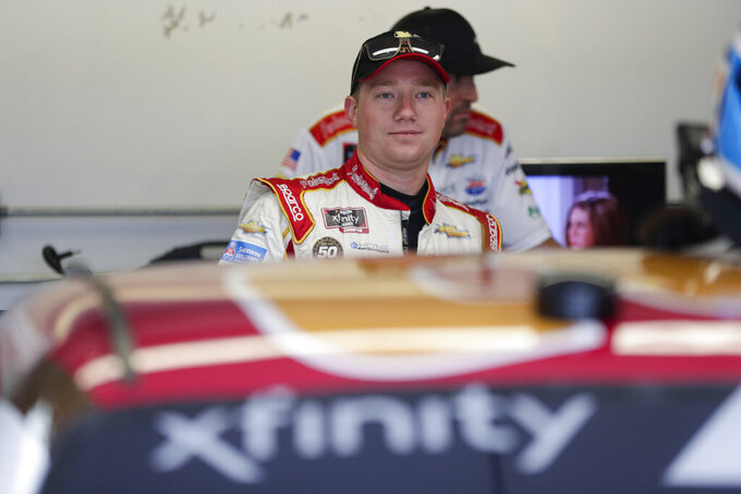 NASCAR Xfinity Series driver Tyler Reddick waits in the garage area before the start of NASCAR Xfinity auto racing practice at Indianapolis Motor Speedway, Friday, Sept. 6, 2019 in Indianapolis. (AP Photo/Michael Conroy)