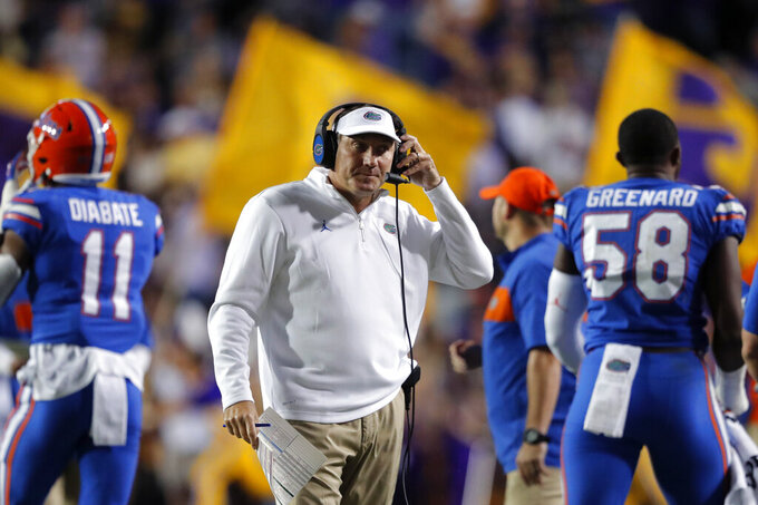 Florida head coach Dan Mullen walks on the sideline in the first half of an NCAA college football game against LSU in Baton Rouge, La., Saturday, Oct. 12, 2019. LSU won 42-28. (AP Photo/Gerald Herbert)