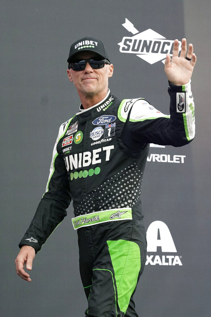 Kevin Harvick waves to fans during driver introductions before the NASCAR Cup Series auto race at Daytona International Speedway, Saturday, Aug. 28, 2021, in Daytona Beach, Fla. (AP Photo/John Raoux)