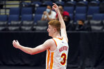 Atlanta Hawks guard Kevin Huerter (3) celebrates his shot at the buzzer during the first half of an NBA basketball game against the Toronto Raptors Tuesday, April 13, 2021, in Tampa, Fla. (AP Photo/Chris O'Meara)