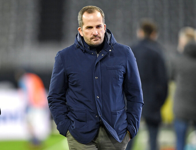 In this Saturday, Oct. 24, 2020 photo Schalke's head coach Manuel Baum walks on the pitch prior to the German Bundesliga soccer match between Borussia Dortmund and FC Schalke 04 in Dortmund, Germany. (AP Photo/Martin Meissner, Pool)