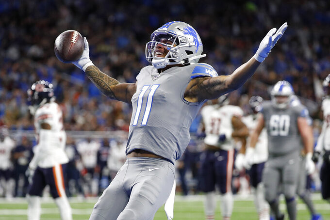 Detroit Lions wide receiver Marvin Jones reacts after scoring on a 8-yard pass reception for a touchdown during the first half of an NFL football game against the Chicago Bears, Thursday, Nov. 28, 2019, in Detroit. (AP Photo/Rick Osentoski)