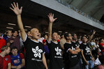 Hong Kong soccer fans wear T-shirt featuring black version of the Hong Kong flags to protest against government during the FIFA World Cup Qatar 2022 and AFC Asian Cup 2023 Preliminary Joint Qualification Round 2 soccer match between Hong Kong and Iran, in Hong Kong, Tuesday, Sept. 10, 2019. The crowd broke out into