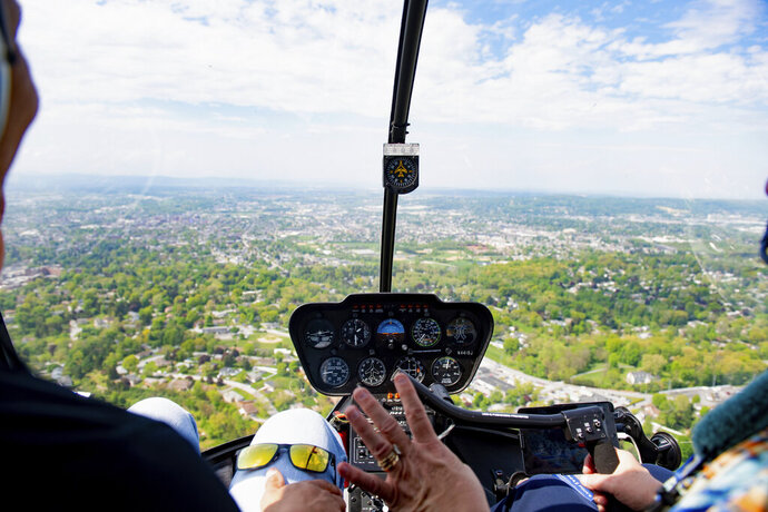 In this May 2, 2019, photo, Judith Redlawsk operates an airplane. Seeing a passenger's nervousness in the air, the silver-haired Redlawsk says,
