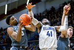 Villanova forward Saddiq Bey (41) and Xavier guard Quentin Goodin (3) reach for a rebound during the first half of an NCAA college basketball game, Monday, Dec. 30, 2019, in Villanova, Pa. (AP Photo/Laurence Kesterson)