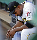 Pittsburgh Pirates pitcher Michael Feliz sits in the dugout after being removed from the team's baseball game after giving up a grand slam to Los Angeles Dodgers' David Freese during the first inning in Pittsburgh, Friday, May 24, 2019. (AP Photo/Gene J. Puskar)