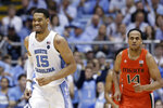 North Carolina forward Garrison Brooks (15) smiles following a basket while Miami center Rodney Miller Jr. (14) runs upcourt during the second half of an NCAA college basketball game in Chapel Hill, N.C., Saturday, Jan. 25, 2020. (AP Photo/Gerry Broome)