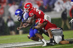Kentucky quarterback Lynn Bowden Jr. (1) is tackled by Georgia linebackers Quay Walker (25) and Nolan Smith (4) during the second half of an NCAA college football game Saturday, Oct. 19, 2019, in Athens, Ga. Georgia won 21-0. (AP Photo/John Bazemore)
