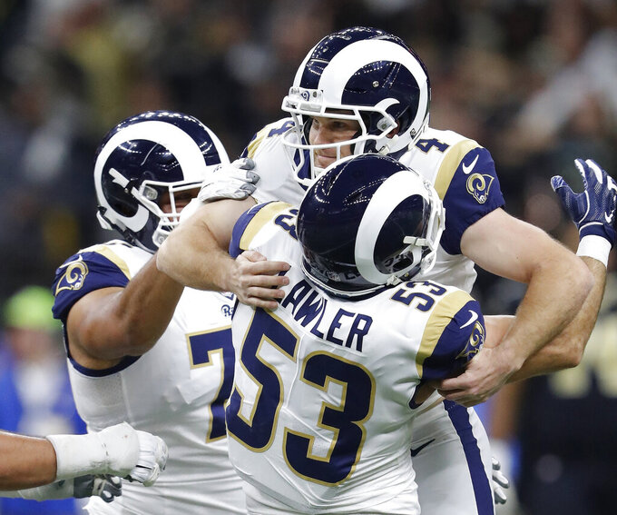 Los Angeles Rams' Greg Zuerlein is congratulated after making the game-winning field goal during overtime of the NFL football NFC championship game against the New Orleans Saints Sunday, Jan. 20, 2019, in New Orleans. The Rams won 26-23. (AP Photo/John Bazemore)