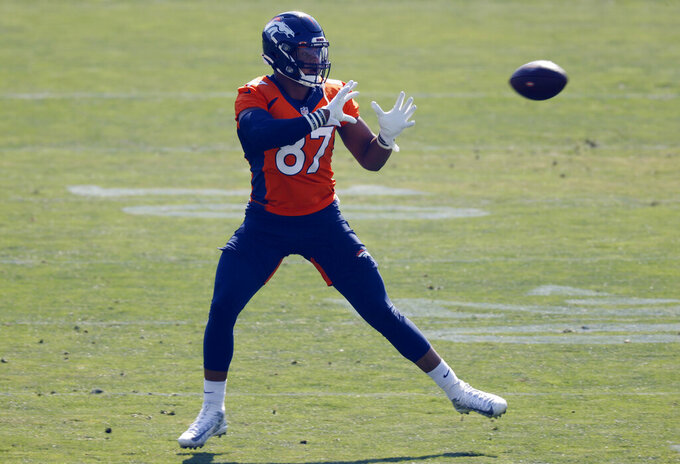 Denver Broncos tight end Noah Fant takes part in drills at the team's NFL football training camp Friday, Aug. 14, 2020, in Englewood, Colo. (AP Photo/David Zalubowski)
