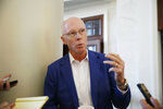 FILE - In this May 21, 2019, file photo, Atlanta Falcons President and CEO Rich McKay speaks to the media during the NFL owners meeting in Key Biscayne, Fla. NFL owners have tabled a proposal that would have offered a fourth-and-15 play as an alternative to the onside kick and approved testing expanded use of video replay in the preseason to aid in officiating. McKay said Thursday, May 28, 2020, there were more clubs receptive to the onside kick alternative than in the past and it will be further explored and likely brought up again. (AP Photo/Brynn Anderson, File)