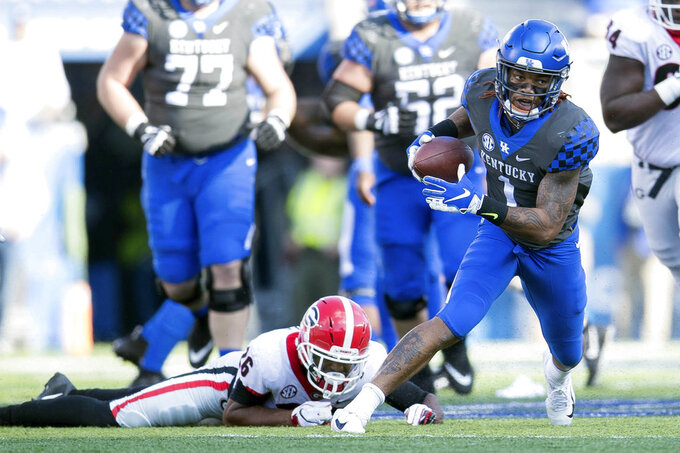Kentucky wide receiver Lynn Bowden Jr. (1) runs with the ball during the first half an NCAA college football game against Georgia in Lexington, Ky., Saturday, Nov. 3, 2018. (AP Photo/Bryan Woolston)