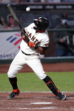 San Francisco Giants' Donovan Solano is hit by a pitch against the Colorado Rockies during the seventh inning of a baseball game on Monday, Sept. 21, 2020, in San Francisco. (AP Photo/Tony Avelar)