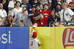 Philadelphia Phillies right fielder Bryce Harper can't make a play on a solo home run hit by New York Yankees' Brett Gardner during the fifth inning of a baseball game on Tuesday, July 20, 2021, in New York. (AP Photo/Adam Hunger)