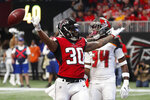 Atlanta Falcons running back Qadree Ollison (30) celebrates his touchdown run against the Tampa Bay Buccaneers during the first half of an NFL football game, Sunday, Nov. 24, 2019, in Atlanta. (AP Photo/John Bazemore)