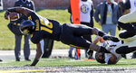 Missouri running back Damarea Crockett, left, dives into the end zone for a touchdown past Vanderbilt linebacker Dimitri Moore during the first half of an NCAA college football game Saturday, Nov. 10, 2018, in Columbia, Mo. (AP Photo/Jeff Roberson)