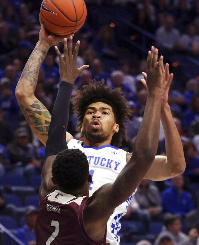 Kentucky's Nick Richards, top, shoots over Eastern Kentucky's Tre King (2) during the first half of an NCAA college basketball game in Lexington, Ky., Friday, Nov. 8, 2019. (AP Photo/James Crisp)