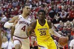 Minnesota's Isaiah Ihnen (35) goes to the basket against Indiana's Trayce Jackson-Davis (4) during the first half of an NCAA college basketball game, Wednesday, March 4, 2020, in Bloomington, Ind. Indiana defeated Minnesota 72-67. (AP Photo/Darron Cummings)