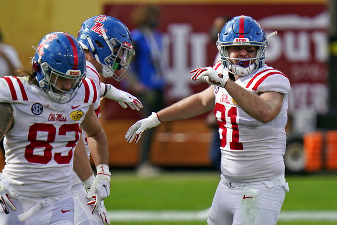 Mississippi tight end Casey Kelly (81) celebrates after catching a touchdown pass against Indiana during the first half of the Outback Bowl NCAA college football game Saturday, Jan. 2, 2021, in Tampa, Fla. (AP Photo/Chris O'Meara)