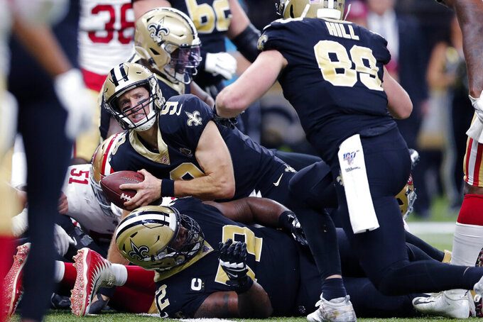 New Orleans Saints quarterback Drew Brees (9) keeps on a touchdown carry in the first half an NFL football game against the San Francisco 49ers in New Orleans, Sunday, Dec. 8, 2019. (AP Photo/Brett Duke)