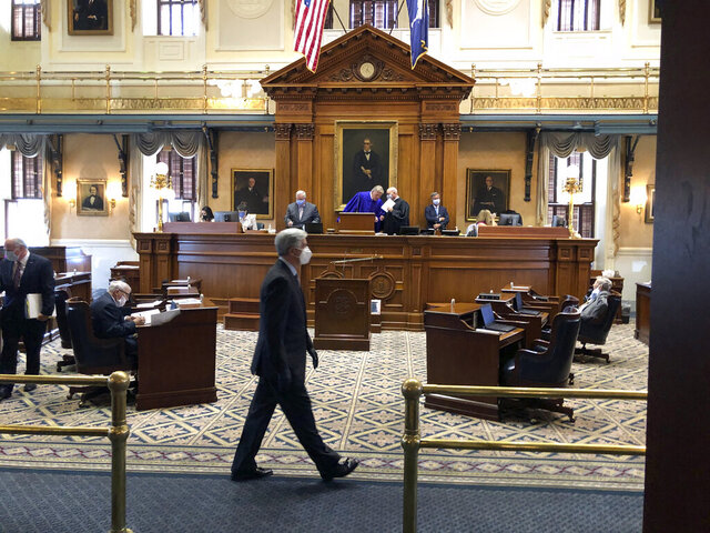 South Carolina Sen. Nikki Setzler, D-West Columbia, walks across the Senate chamber on Tuesday, June, 23, 2020, in Columbia, S.C. Senators were meeting to debate how to spend nearly $2 billion in federal money for COVID-19 relief (AP Photo/Jeffrey Collins)