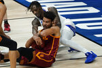 USC forward Evan Mobley (4) tries to protect the ball from Kansas guard Marcus Garrett (0) during the first half of a men's college basketball game in the second round of the NCAA tournament at Hinkle Fieldhouse in Indianapolis, Monday, March 22, 2021. (AP Photo/Paul Sancya)
