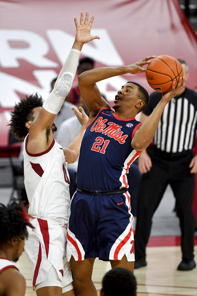 Mississippi forward Robert Allen (21) shoots over Arkansas defender Justin Smith (0) during the second half of an NCAA college basketball game Wednesday, Jan. 27, 2021, in Fayetteville, Ark. (AP Photo/Michael Woods)