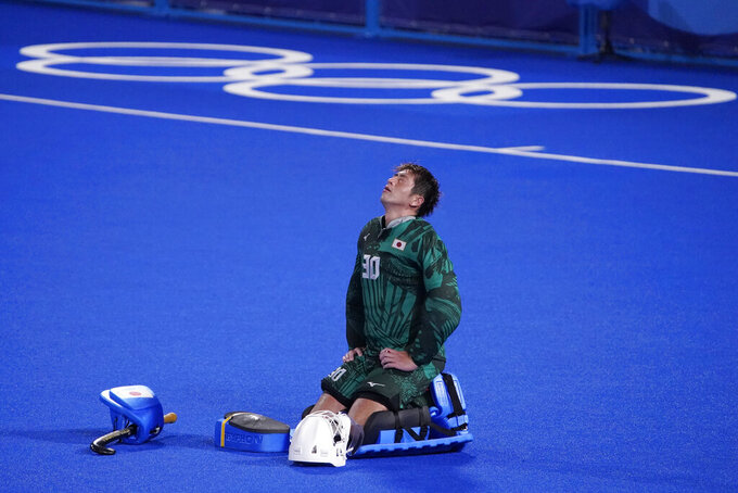 Japan goalkeeper Takashi Yoshikawa reacts after Japan lost to Spain in a men's field hockey match at the 2020 Summer Olympics, Wednesday, July 28, 2021, in Tokyo, Japan. (AP Photo/John Locher)