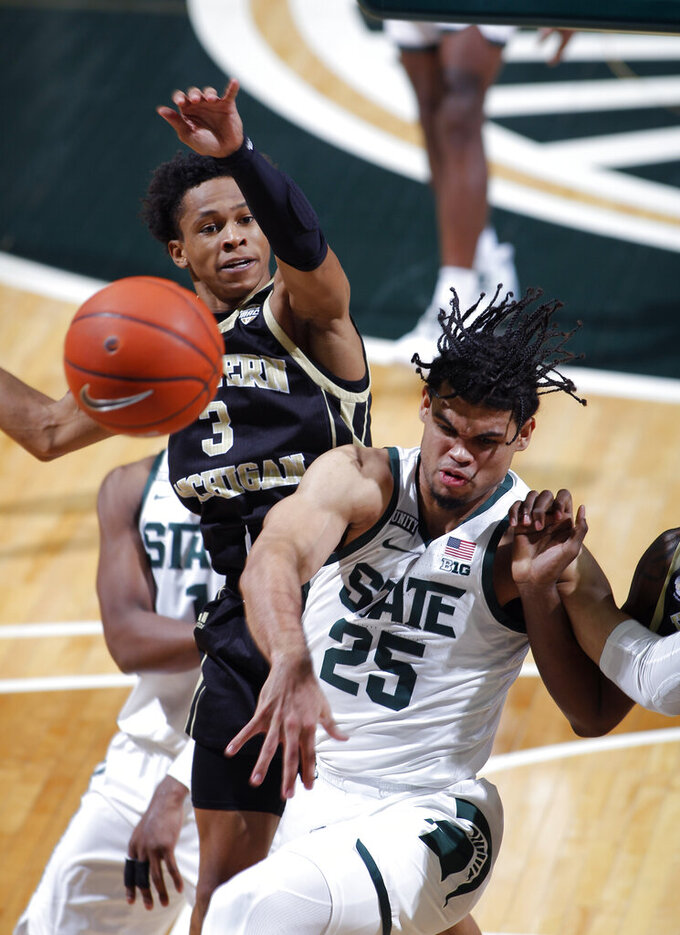 Michigan State's Malik Hall, right, and Western Michigan's B Artis White (3) battle for a rebound during the second half of an NCAA college basketball game, Sunday, Dec. 6, 2020, in East Lansing, Mich. Michigan State won 79-61. (AP Photo/Al Goldis)