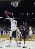 Maryland 's Anthony Cowan Jr. (1) goes up for a shot past Belmont 's Nick Hopkins (14) during the second half of a first round men's college basketball game in the NCAA Tournament in Jacksonville, Fla., Thursday, March 21, 2019. (AP Photo/John Raoux)
