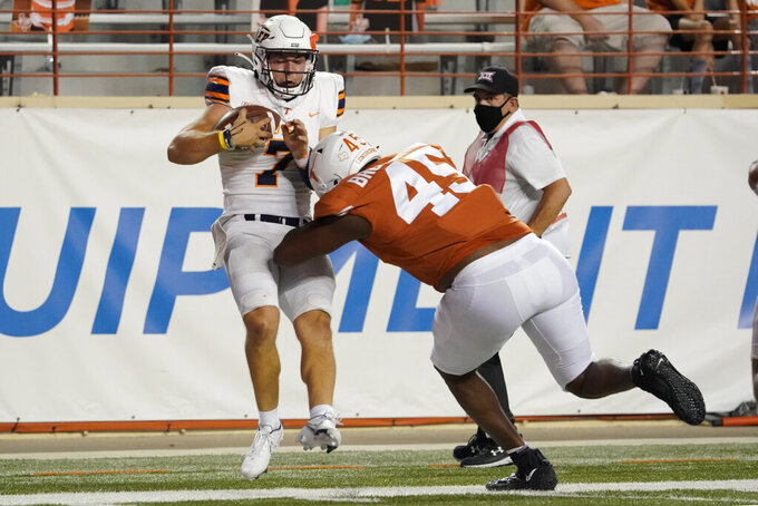 UTEP's Calvin Brownholtz (7) is hit by Texas' Vernon Broughton (45) as he goes out of bounds during the second half of an NCAA college football game in Austin, Texas, Saturday, Sept. 12, 2020. (AP Photo/Chuck Burton)