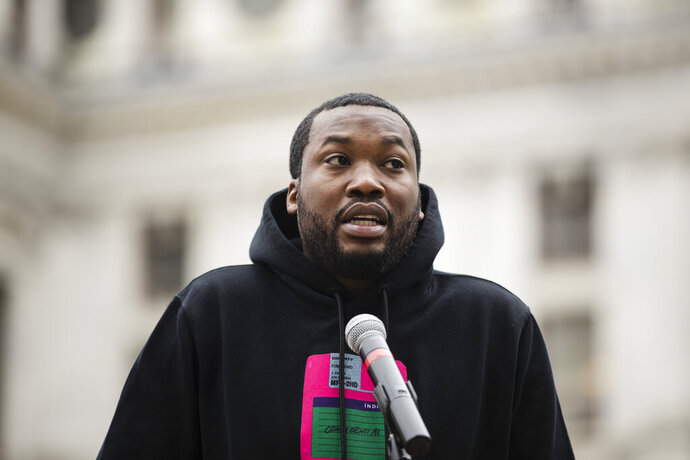 FILE - In this April 2, 2019, file photo, rapper Meek Mill speaks at a gathering in Philadelphia to push for drastic changes to Pennsylvania's probation system. Philadelphia's District Attorney's office wants a new trial with a new judge for rapper Meek Mill. Larry Krasner submitted the brief Wednesday, May 22, 2019. He said former Judge Genece Brinkley's court
