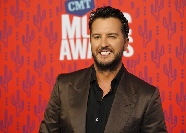 FILE - In this June 5, 2019 file photo, Luke Bryan arrives at the CMT Music Awards at the Bridgestone Arena in Nashville, Tenn. A Tennessee wildlife official says a nonnative red stag that was shot and killed last week belonged to the country music singer. Wildlife Resources Agency spokesman Barry Cross told The Tennessean investigators think the deer was shot from the road onto Bryan's private property near Columbia between Wednesday, Dec. 4 and Friday, Dec. 6. (AP Photo/Sanford Myers, File)