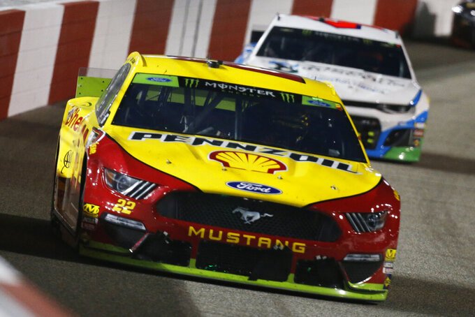 Joey Logano (22) drives into turn one during the NASCAR Monster Energy Cup series auto race at Richmond Raceway in Richmond, Va., Saturday, Sept. 21, 2019. (AP Photo/Steve Helber)