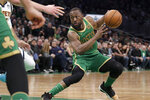 Boston Celtics guard Kemba Walker makes a move with the ball in the second half of an NBA basketball game against the Denver Nuggets, Friday, Dec. 6, 2019, in Boston. (AP Photo/Elise Amendola)
