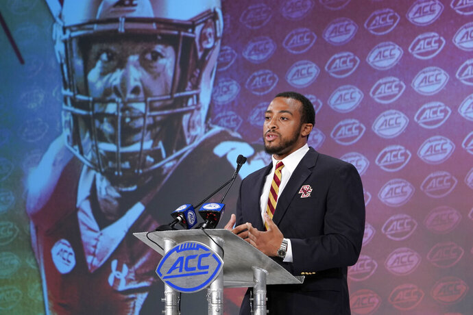 Boston College's AJ Dillon speaks during the Atlantic Coast Conference NCAA college football media day in Charlotte, N.C., Wednesday, July 17, 2019. (AP Photo/Chuck Burton)