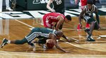 Michigan State's Joshua Langford, left, and Rocket Watts, right, and Wisconsin's D'Mitrik Trice vie for the ball during the first half of an NCAA college basketball game, Friday, Dec. 25, 2020, in East Lansing, Mich. Wisconsin won 85-76. (AP Photo/Al Goldis)