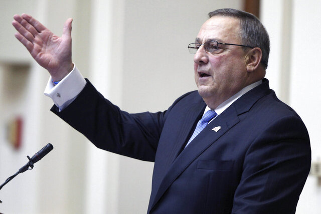 FILE— In this Feb. 4, 2014, file photograph, then-Maine Gov. Paul LePage delivers his State of the State address to the Democratic-controlled Legislature at the Statehouse in Augusta, Maine. The Sun Journal reports that the snowbird who lives in Florida in the winter has registered to vote in the Sunshine State, where he and his wife, Ann, bought a house in 2018 in a gated, private golf community in Ormond Beach. (AP Photo/Joel Page, File)